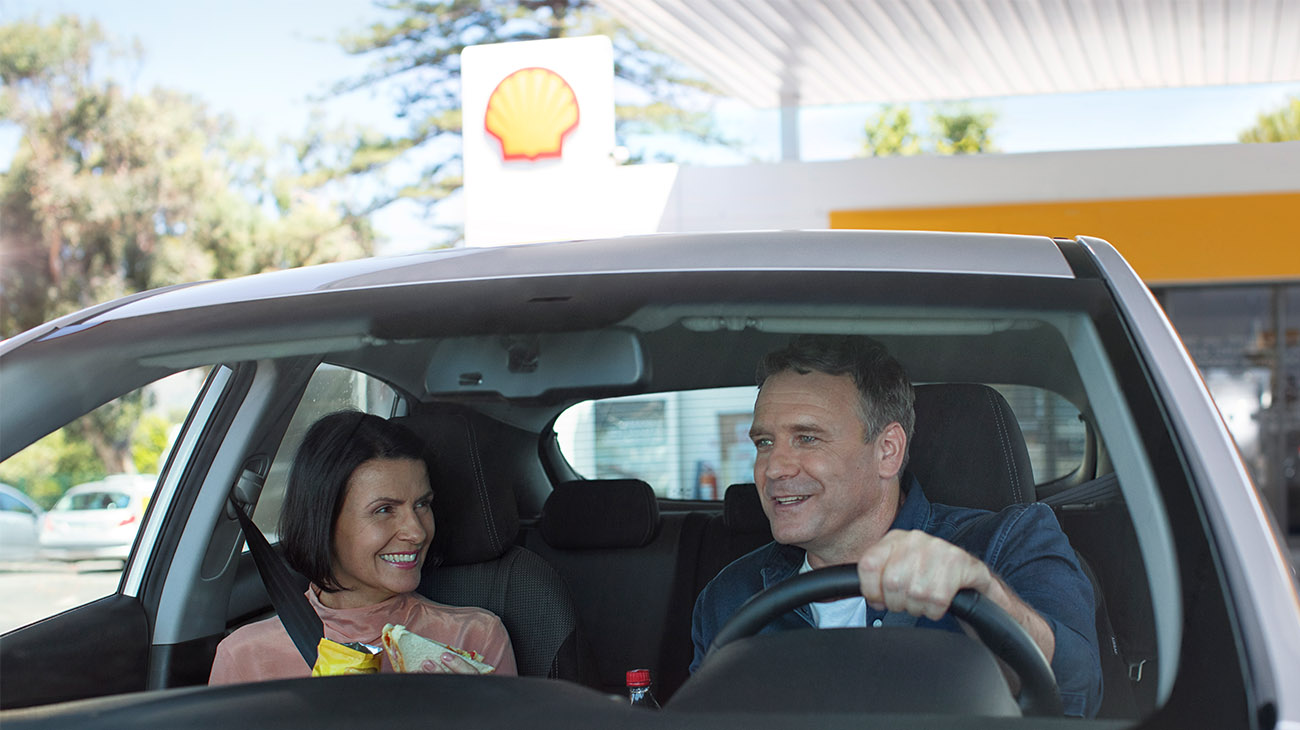 Couple in a car at Shell retail station